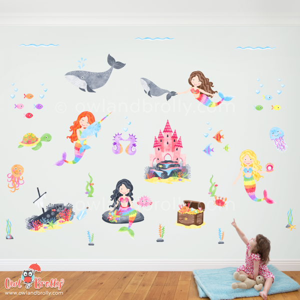 Large mermaid wall sticker decal scene filled with rainbow coloured removable and reusable fabric wall stickers. a coral castle, 4 mermaids, a narwhal, whales and lots of fish, perfect for that bright colourful nursery or kids room decor.