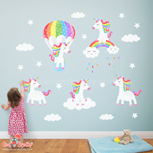 Unicorn wall art decals. 5 rainbow coloured unicorns on a removable and reusable fabric wall sticker, complete with clouds and stars. The perfect set for a coloured large wall in a playroom or nursery room.