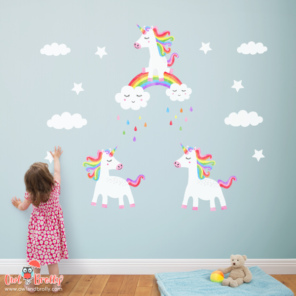 3 rainbow unicorn wall sticker decals, ideal for a feature wall or over a bed. Featuring 3 different white and coloured unicorns, clouds and stars. Also available in other colours