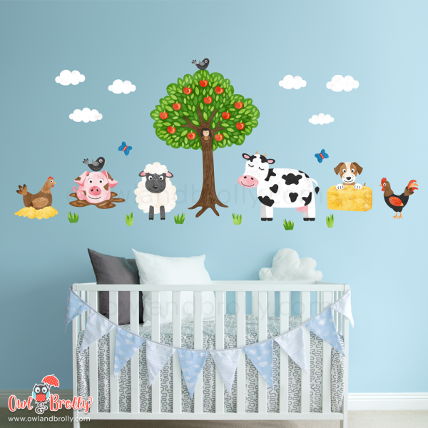 Small farmyard fabric wall sticker nursery wall art scene from Owl and Brolly. Farm animals including cow, sheep, pig, hen, cockerel, puppy and apple tree. An ideal set to go above children's bedroom furniture.