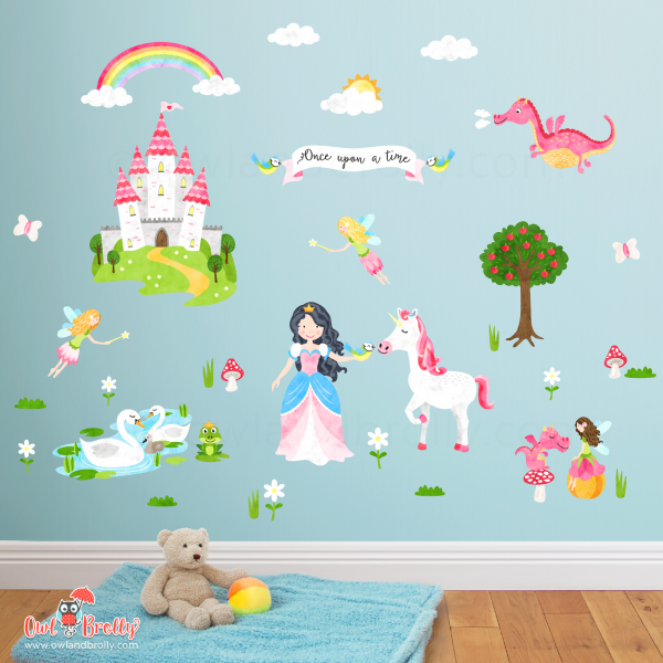 Enchanted fairytale princess unicorn wall sticker decals. This large wall sticker set is filled with fairytale kingdom favourites, a princess and unicorn, pink dragon, fairies, fairytale castle, rainbow, once upon a time banner, frog prince, swans and lots of grasses and flowers. All illustrated and printed at Owl and Brolly, on a removable and re-usable fabric sticker.