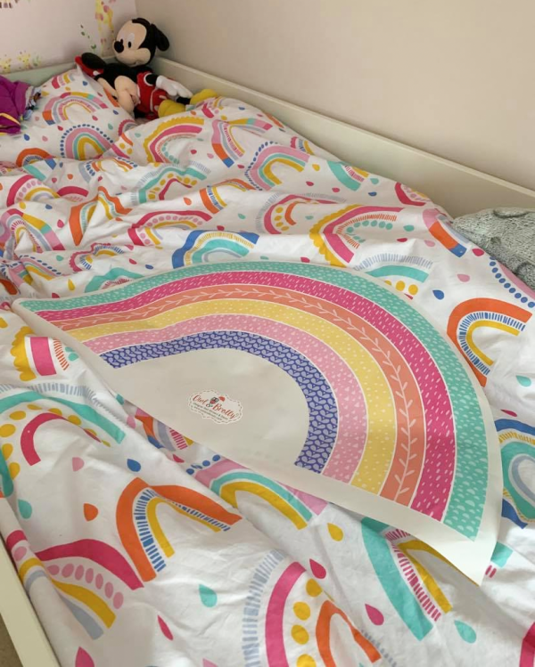 Colour matched rainbow wall sticker to go with rainbow bedding.